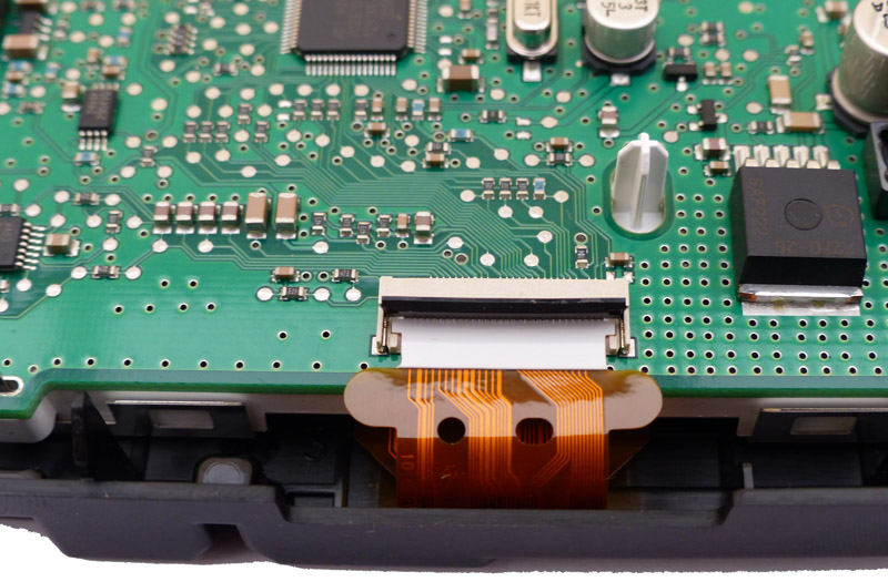 Lift up the brown retainer to release the ribbon cable